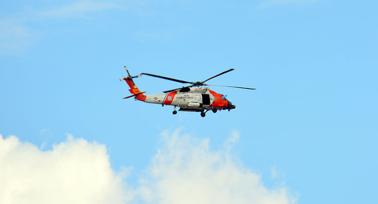 A USCG helicopter flying above U.S. Coast Guard Air Station Elizabeth City
